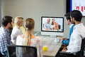 Business people looking at a screen during a video conference Royalty Free Stock Photo