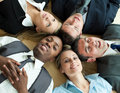 Business people lying in a circle on the floor Stock Image