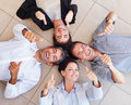 Business people lying in a circle on the floor Royalty Free Stock Images