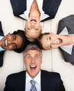 Business people lying in a circle on the floor Royalty Free Stock Photography