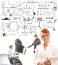 Business people and many business elements young businesswoman in front of some shaking hands a conceptual drawing with economisc Royalty Free Stock Photo