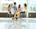 Business people meeting in circle of chairs Royalty Free Stock Photo