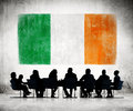 Business People in a Meeting with Irish Flag Royalty Free Stock Photo