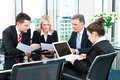 Business people meeting in an office the businesspeople are discussing a document Royalty Free Stock Photo