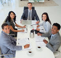Business people in a meeting smiling Stock Photos