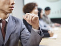 Business people negotiating in meeting and or Stock Photo