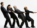Business people playing tug-of-war Stock Photography