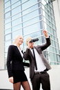 Business people pointing binoculars successful standing in front of building and looking Royalty Free Stock Photography