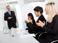 Business people at presentation applauding Royalty Free Stock Photo
