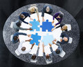Business people with puzzle pieces and teamwork concept Royalty Free Stock Photos