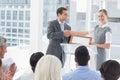 Business people receiving award in meeting room Stock Image