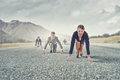 Business people running race on road in start position ready to run Stock Image