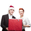 Business people santa hat holding present big red isolated on white Stock Photography