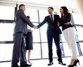 Business people shaking hands finishing up meeting a Royalty Free Stock Image