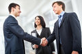 Business people shaking hands in modern office Stock Photo