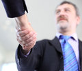 Business people shaking hands over a deal Stock Photography