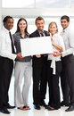 Business people showing a big white card Royalty Free Stock Photo