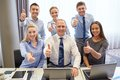 Business people showing thumbs up in office Royalty Free Stock Photo