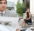 Business people sitting classic coffee shop terrace using technology reading newspaper outdoors Royalty Free Stock Image