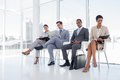 Business people sitting in waiting room with big windows Royalty Free Stock Photos