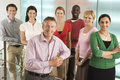 Business people smiling in office group portrait of multiethnic Stock Photos