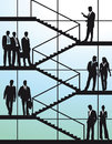 Business people on stairs silhouetted stood in modern building Royalty Free Stock Image