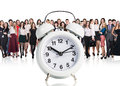 Business people stand near big alarm clock Royalty Free Stock Photo