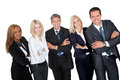 Business people standing with hands folded against white background Stock Photo