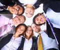 Business people standing in huddle Royalty Free Stock Photos