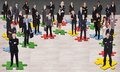 Business people standing on jigsaw pieces Royalty Free Stock Photo