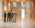 Business people standing at the office lobby Stock Images