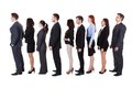 Business people standing in queue over white background Stock Images