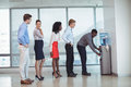 Business people standing by water cooler at office Royalty Free Stock Photo
