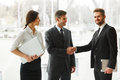 Business people successful business partner shaking hands in th the office team Stock Image