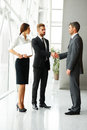 Business people successful business partner shaking hands in th the office team Stock Photos