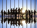 Business people at sunset working Royalty Free Stock Photography