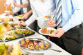 Business people take buffet appetizers Royalty Free Stock Image