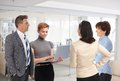 Business people talking at office meeting in lobby working together Royalty Free Stock Image