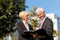 Business people talking outdoors Stock Photo