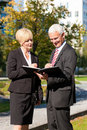 Business people talking outdoors Royalty Free Stock Image