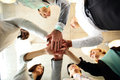 Business people teamwork in an office with hands together Stock Photo