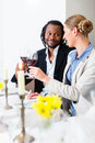 Business people toasting on deal with wine Royalty Free Stock Photo