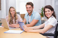 Business people using digital tablet and laptop in meeting Royalty Free Stock Photo