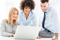 Business people using laptop together working smiling Royalty Free Stock Image