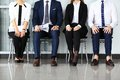 Business people waiting for job interview four candidates competing one position Royalty Free Stock Image