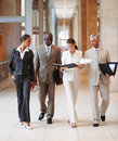Business people walking through the hallway Royalty Free Stock Photos
