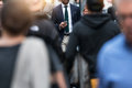 Business people walking from the job in busy city street. Royalty Free Stock Photo