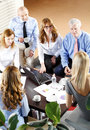Business people at work high angle view of financial sitting meeting businesswomen and businessmen sitting desk in front of Royalty Free Stock Image