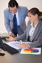 Business people working on diagrams together Royalty Free Stock Photos