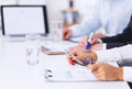 Business people working on project in office sitting the desk Royalty Free Stock Images